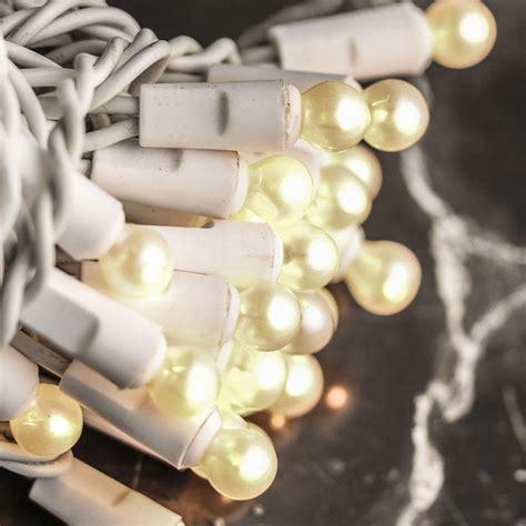 pearl white globe bulb and white cord string lights