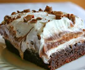 brownie refrigerator cake with layers of brownie chocolate pudding cheese