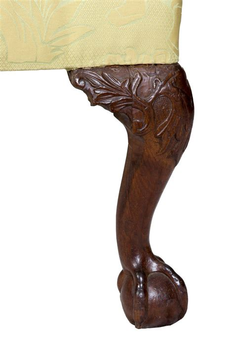 chippendale wing chair on carved legs with claw and