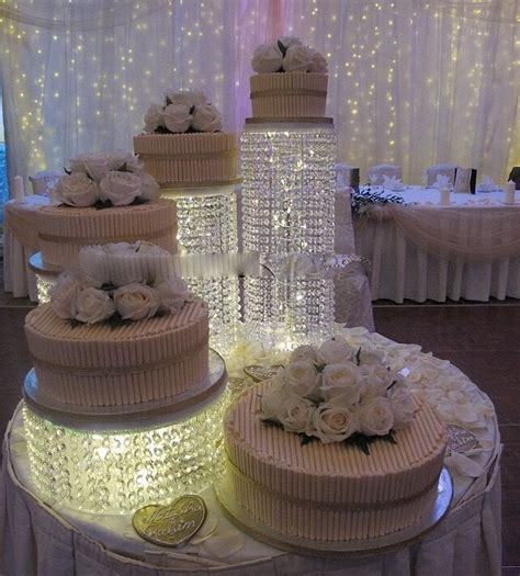 wedding cake stands  tiers flowers crystal chandelier