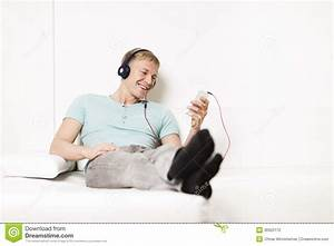 Young Man Listening Music With Headphones And Resting On ...