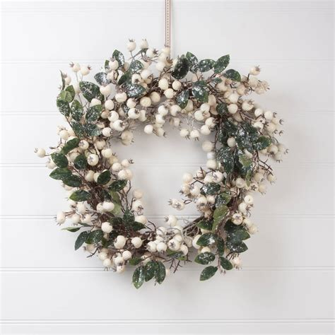 white snow berry christmas wreath by the christmas home