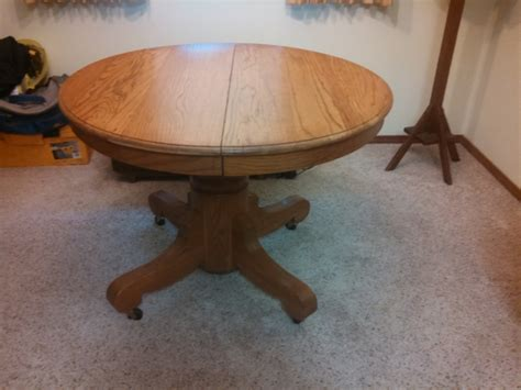 antique oak pedestal dining table with 2 leaves