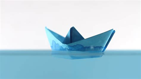 Origami Boat In Water by Blue Paper Boat On Surfaces Of Water Stock Footage