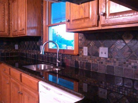 Uba Tuba Granite Countertops with Slate Tile Backsplash