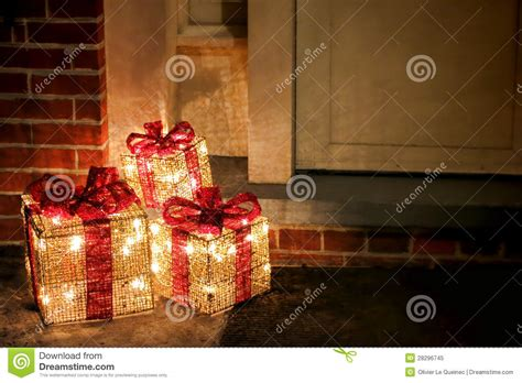 lighted decorated christmas gifts boxes  doorway royalty