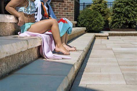kids sitting  ledgestone steps   pool