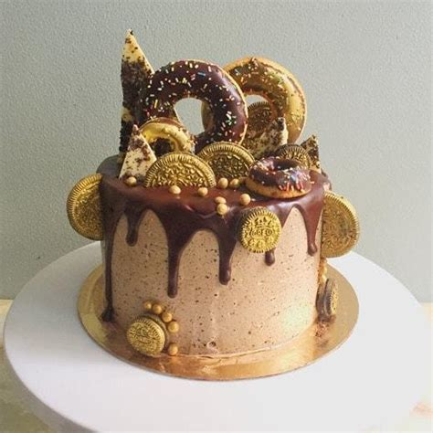 bespoke doughtnut topped cake with gold lustre oreos anges de sucre