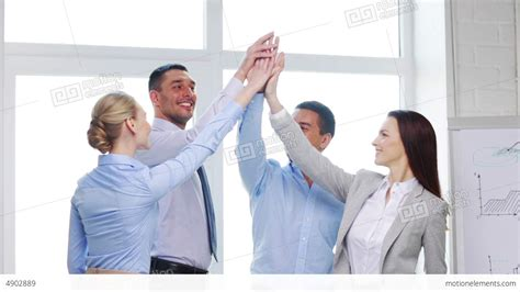 bureau high business team doing high five gesture in office stock