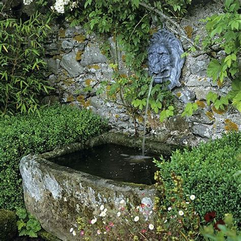 rustic garden features traditional wall fountain and stone basin housetohome co uk