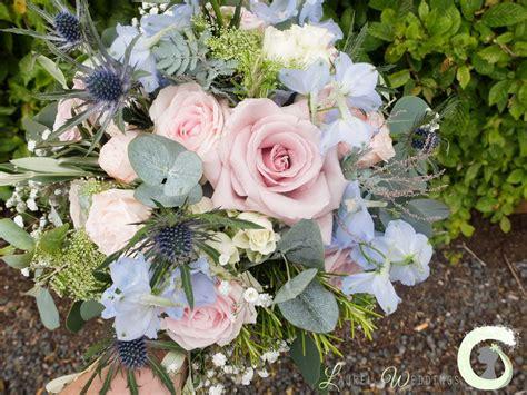 rustic wedding bouquet  roses delphinium  eryngium
