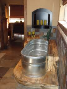 feed trough bathtub with old hand pump faucet i still