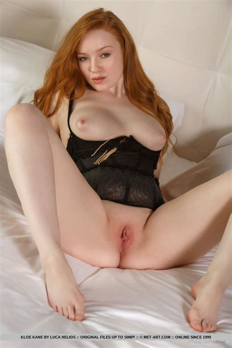 Tight Busty Redhead In A Black Corset
