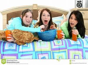 Teens Watching TV at Home stock photo. Image of sleepover ...