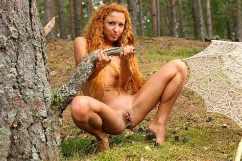Redhead Ladyman With Curly Brow