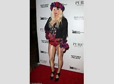Kesha is full of the joys of spring as she steps out in a