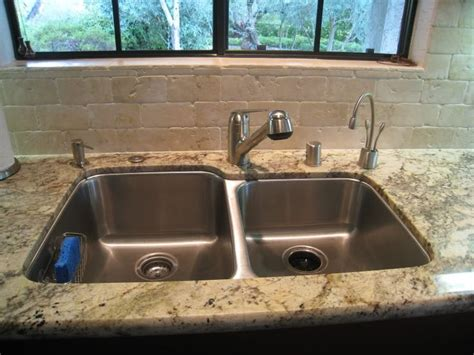 bordeaux granite counters and subway tile