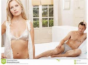 Man and woman in bedroom. stock image. Image of discontent ...