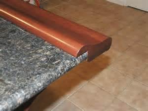 kitchen granite countertop ideas chicago bar rail fastened to granite