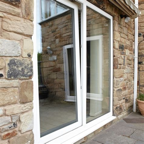 simple white patio doors with windows and brick