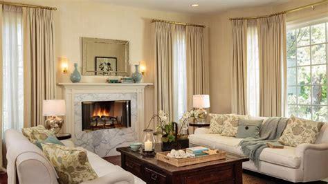 living rooms large windows cream  aqua color