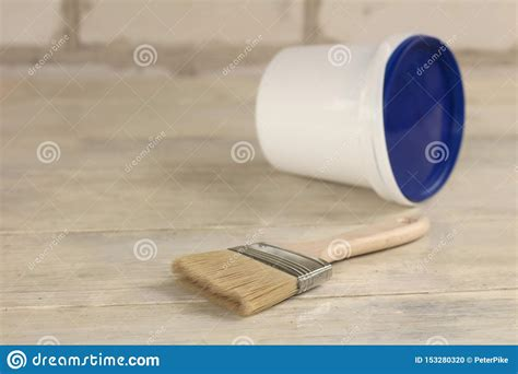 Just need few a minutes and your design will be look great with this mockup. A Paint Brush Is Next To A Plastic Paint Bucket With A ...
