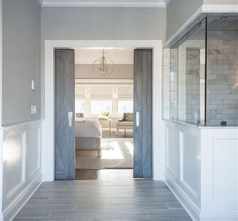gray pocket doors leading  master bedroom wall color