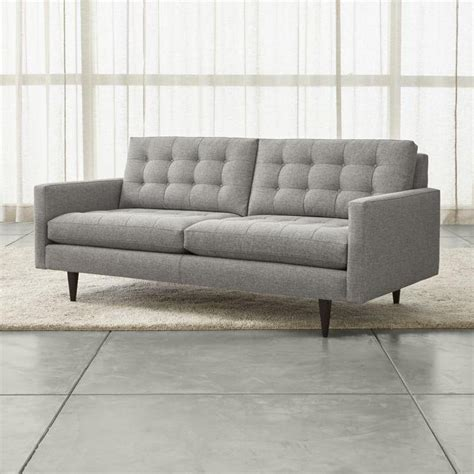 large gray midcentury button tufted sofa