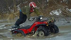 Two Honda 350 Fourtrax In Some Ice