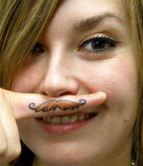 color mustache tattoo  girl finger