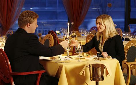 romantic dinner raised cups white wine toast love couple