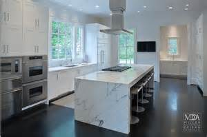 kitchen island with cooktop waterfall island modern kitchen mdd architects