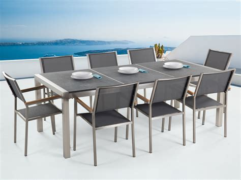 outdoor dining set flamed granite top and gray chairs