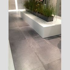 Use A Large Format Concrete Looking Tile Indoors For An