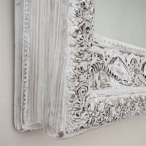 carved white 'shabby chic' mirror by decorative mirrors
