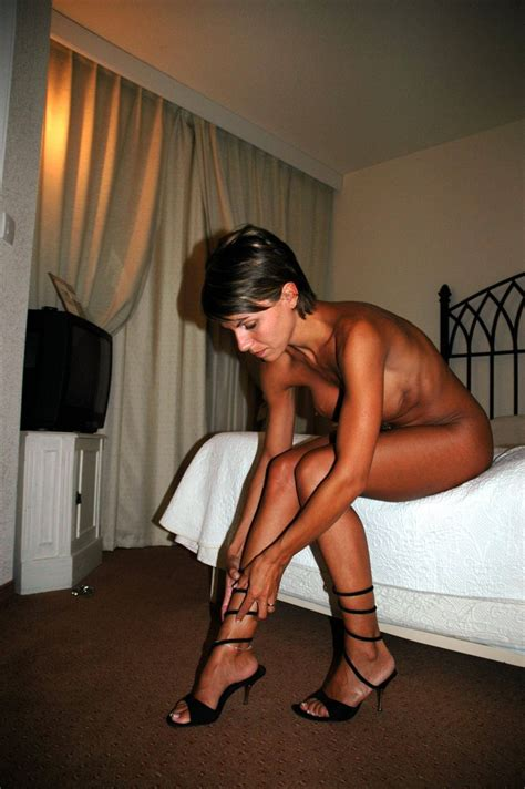 Tanned Milf On The Bed Milf Luscious