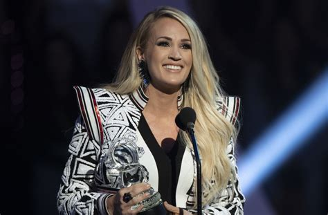 Carrie Underwood Shows Glimpse Of Baby Bump In New Music