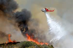 Three wildfires sweep through California forcing mass home ...