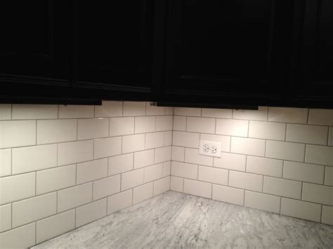 light gray grout with brick pattern white subway tile back