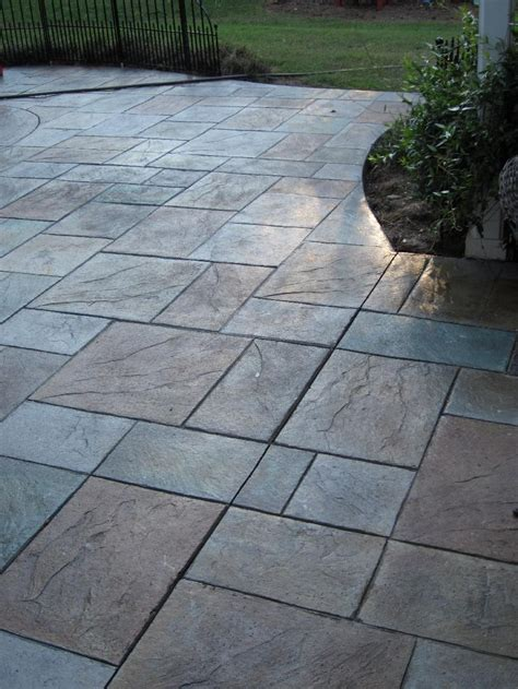 colored sted concrete patio with pit