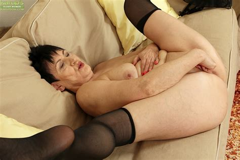 Older Woman Karoline Stripping Off Black Stockings And