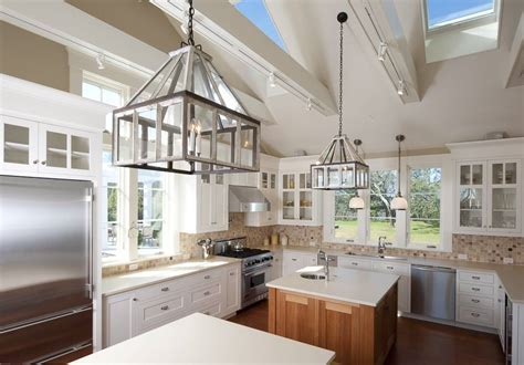 Kitchen cabinets with vaulted ceiling and skylights windows