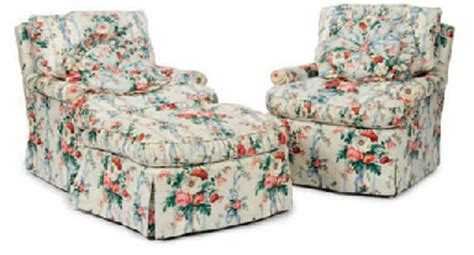 a pair of chintz upholstered club chairs and a matching