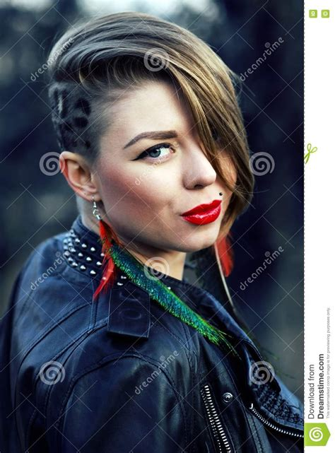 hipster girl  leopard haircut  outdoors stock