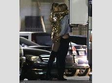Miley Cyrus passionately kisses Victoria's Secret Angel