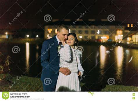 Romantic Wedding Bride And Groom Posing Near Night Pond