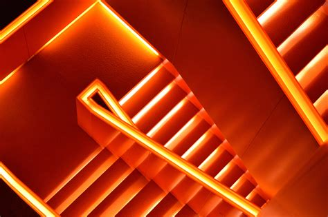 Aesthetic Orange Wallpaper Laptop by Photo Of Stairs With Orange Led Light Hd Wallpaper