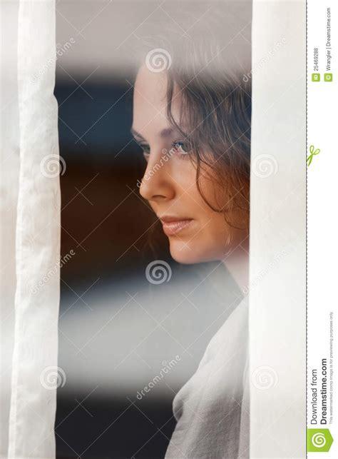 sad beautiful woman   window royalty  stock  image