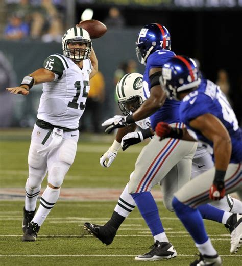 New York Jets quarterback Tim Tebow rushes against the New ...