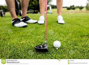 Male Instructor Assisting Woman In Learning Golf Royalty ...